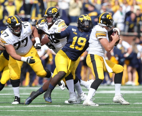 Michigan football DE Kwity Paye will play for Wolverines this season