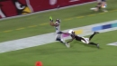 VIDEO: Seahawks' Russell Wilson connects with Tyler Lockett on insane TD catch falling off end zone
