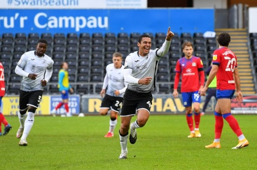 Cabango and Ayew goals lift Swans up to second in the Championship