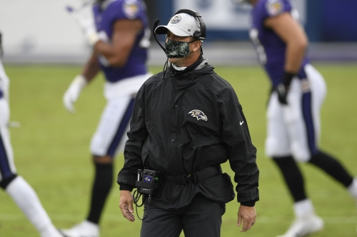 Ravens coach John Harbaugh separated from Titans players in pregame confrontation