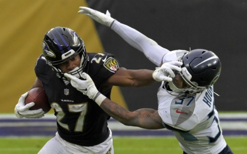Where do the Ravens stand in the AFC playoff race after their overtime loss to the Titans?