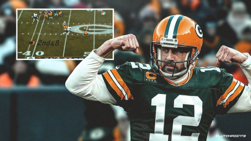 Packers' Aaron Rodgers throws TD pass from the logo for historic NFL milestone