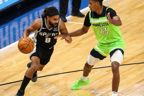 Spurs show grit in overtime win over Timberwolves