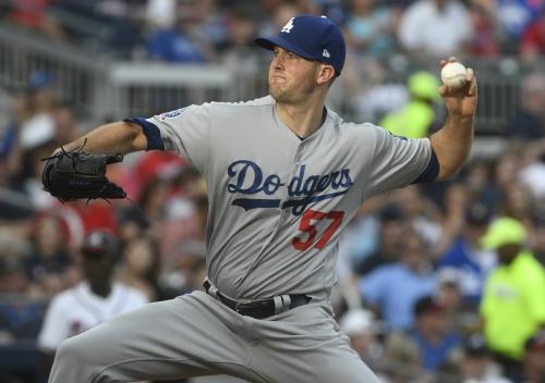 Free agent left-hander Alex Wood leaves Dodgers for rival Giants