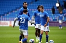 Cardiff City players wear T-shirts in support of team-mate Sol Bamba