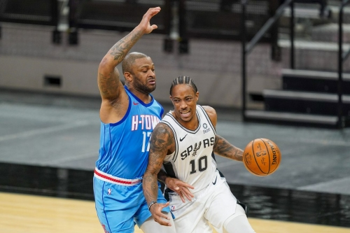 Spurs strike late to beat shorthanded Rockets