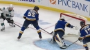 Couture banks one off Binnington from behind the goal line