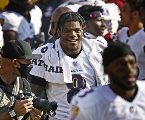 Ravens' John Harbaugh 'totally certain' QB Lamar Jackson will sign long-term contract extension