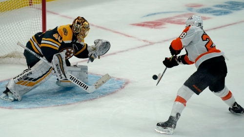 Bruins rally past Flyers for shootout win in home opener