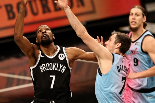 Kevin Durant and Kyrie Irving combine for 59 as Nets bounce back, beating Heat, 128-124