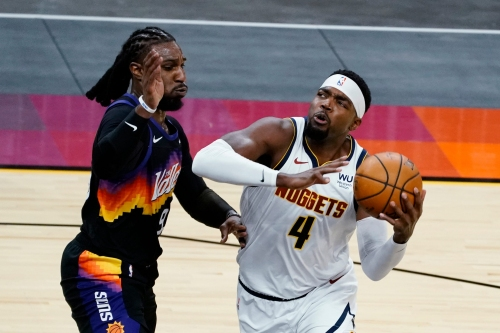 Without Booker, Suns battle, but fizzle out in double overtime loss to Nuggets