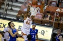 No. 14 Texas topples No. 17 Kansas in overtime with big second-half comeback