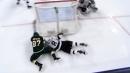 Kaprizov scores wraparound while getting hauled down by Doughty