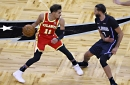 Hawks ride three-point wave, end first half with win over Magic