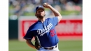 Dodgers' Clayton Kershaw makes spring debut – as a World Series champ