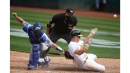Dodgers strand 14 runners, lose to A's in 10 innings