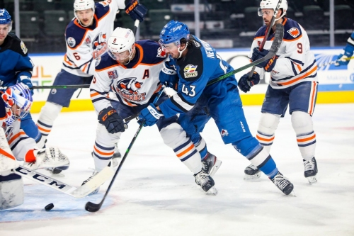 Alex Newhook makes pro debut for the Colorado Eagles